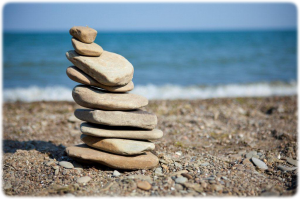 "Stack of Rocks Balancing on Lake Erie Shore –""©iStockphoto.com/Sharon Dominick"""